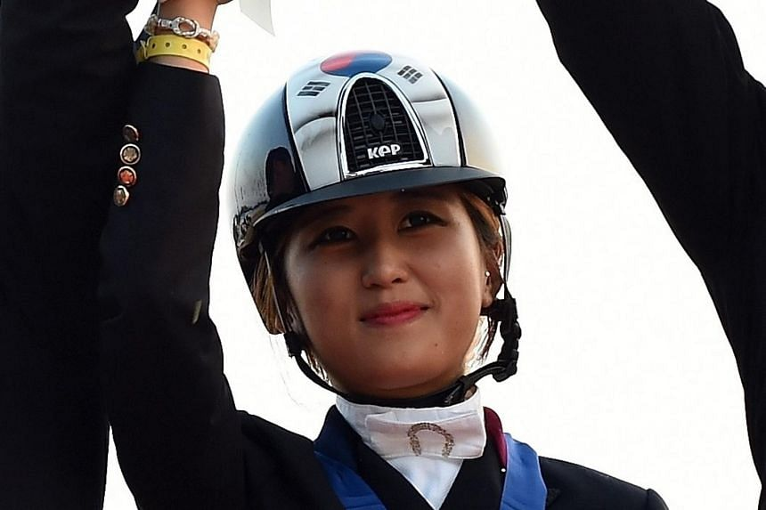 A file photo of Chung Yoo Ra after winning the gold in the equestrian dressage team competition at the 2014 Asian Games.
