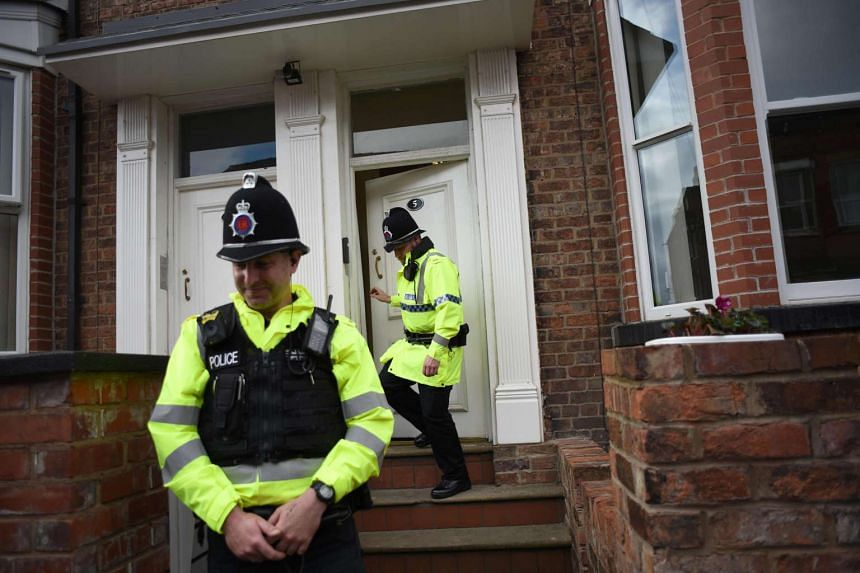 Police officers standing guard outside a residential property following a raid, in London on May 30, 2017.