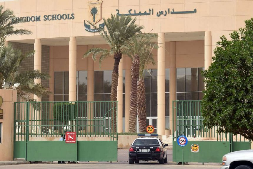 A police car entering the Kingdom Schools building in Riyadh through the main entrance after a shooting there, on May 31, 2017.