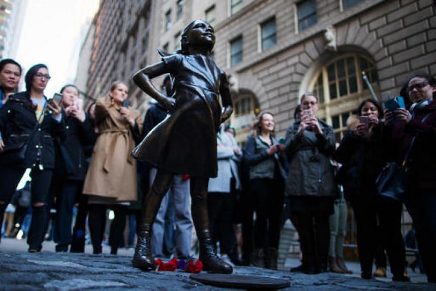 Fearless girl was placed opposite the bull, staring it down on March 7, 2017.