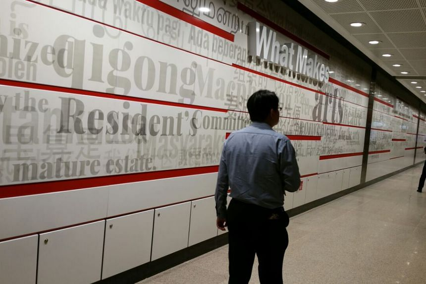 An artwork on the wall, with the words What Makes Macpherson Home Is The People, at Macpherson station.