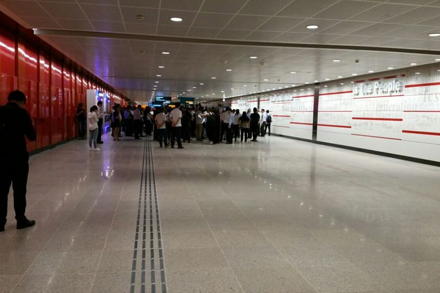 People look around the new Macpherson station.