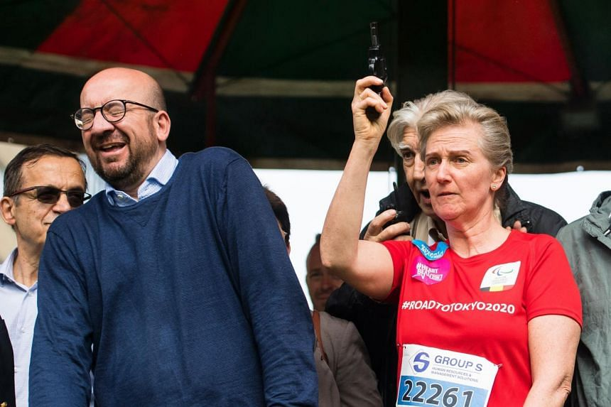 Belgian Prime Minister Charles Michel reacts as Princess Astrid of Belgium gives the start of the 38th edition of the Brussels' 20km run.