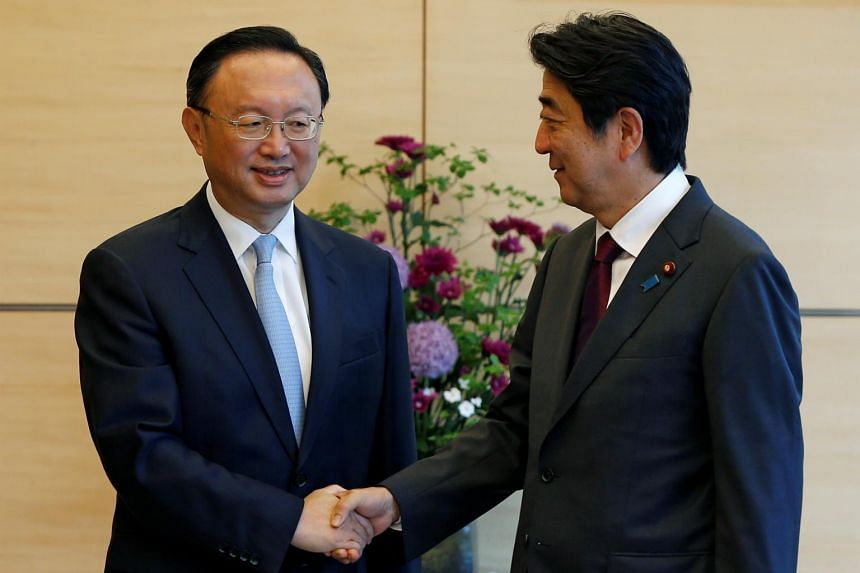 China's State Councillor Yang Jiechi (left) meets Japan's Prime Minister Shinzo Abe at Abe's official residence in Tokyo, Japan, on May 31, 2017.