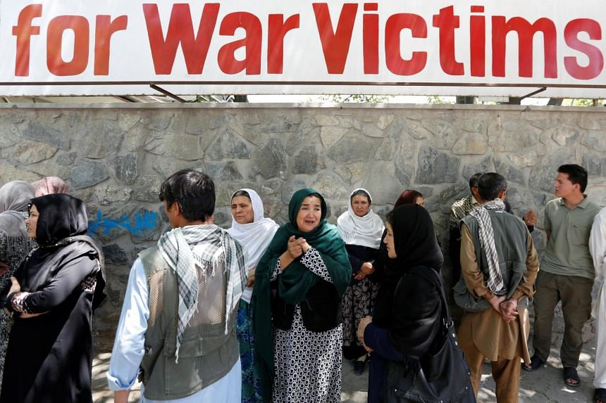 Afghan women mourn outside a hospital after the blast in Kabul, Afghanistan on May 31, 2017.