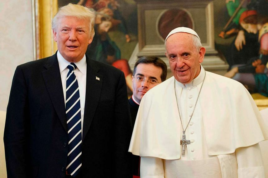 Pope Francis stands with US President Donald Trump during a private audience at the Vatican on May 24, 2017.