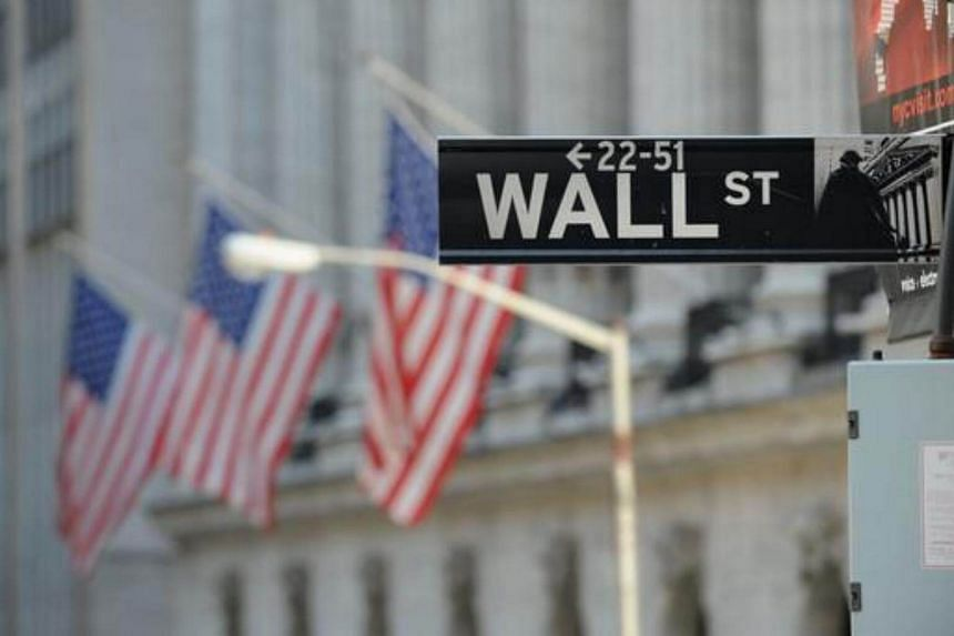 Wall Street sign outside the New York Stock Exchange in New York, on Feb 28, 2012.
