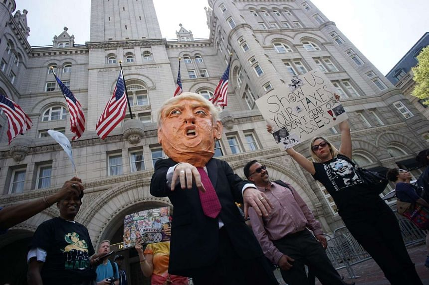 Protesters outside the Trump Hotel in Washington on April 15, 2017.