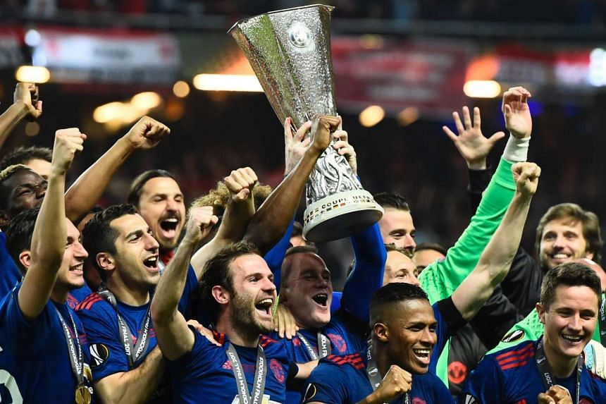 Manchester United players celebrate with the trophy after winning the Uefa Europa League final football match between Ajax Amsterdam and Manchester United at the Friends Arena in Solna outside Stockholm on May 24.