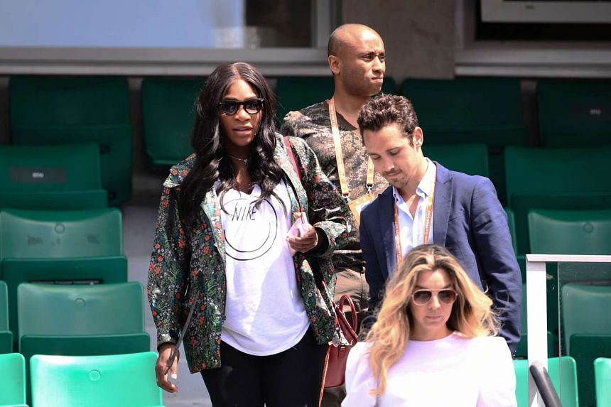 Pregnant Serena Williams (left) leaves after attending sister Venus' French Open match, May 31, 2017.