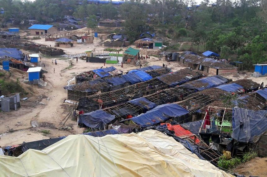 Houses belonging to Rohingya refugees and damaged by Cyclone Mora are seen at a camp in the Cox's Bazar district on May 31, 2017.