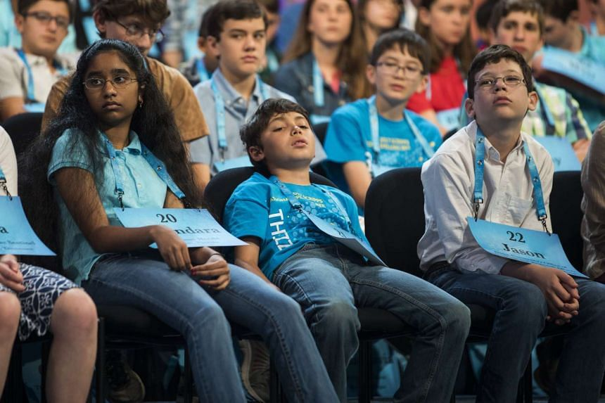 Sakiusa Meador, eight, from Marbleton, Wyoming (centre) watches the competition during round two.