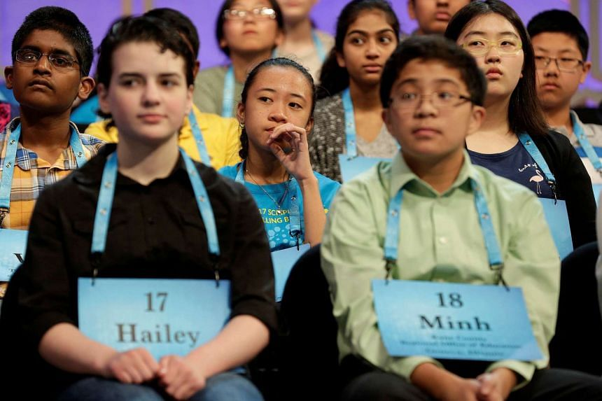 Avril Regis (centre), 14, of Pago Pago, American Samoa, watches the competitors.