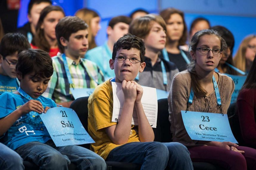 Jason Sorin, 11, from Durham, North Carolina (centre) watches round three of the 2017 Scripps National Spelling Bee.