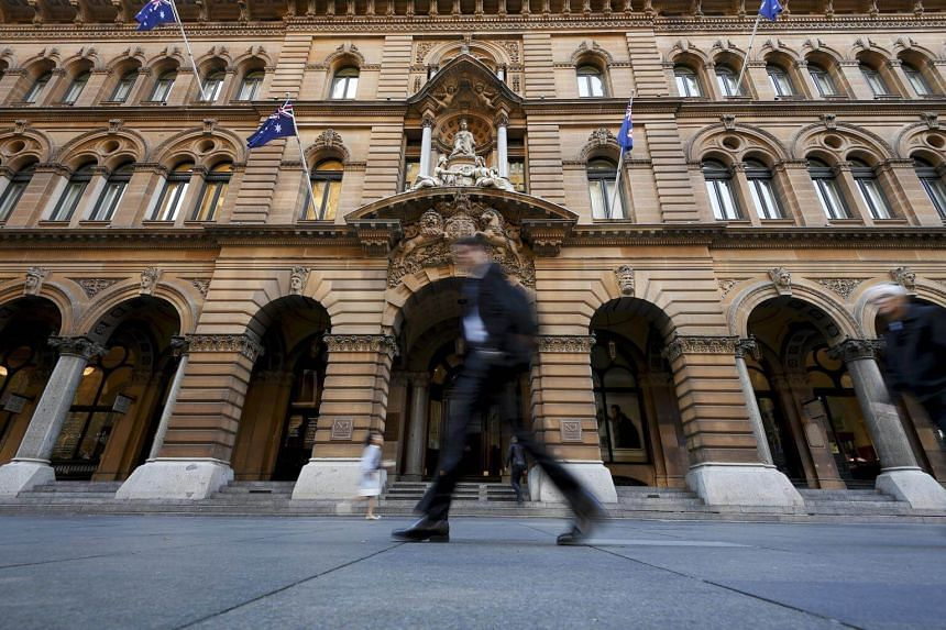People walk in front of the General Post Office building at Martin Place, Sydney, New South Wales, Australia, on June 1, 2017.