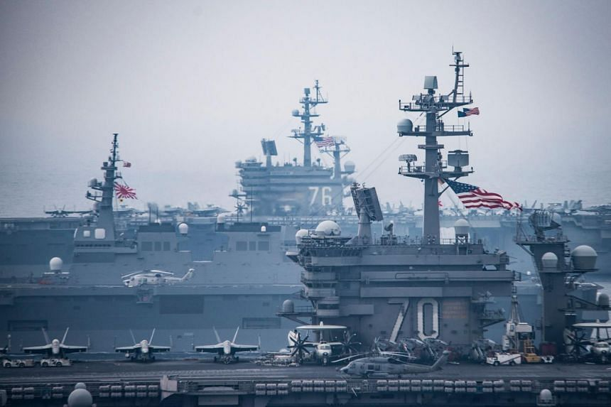 This photo taken on June 1, 2017, shows the Carl Vinson strike group with the USS Ronald Reagan and Japanese ships in the Sea of Japan off the Korean peninsula, where a North Korean missile landed during a test fire on May 29.