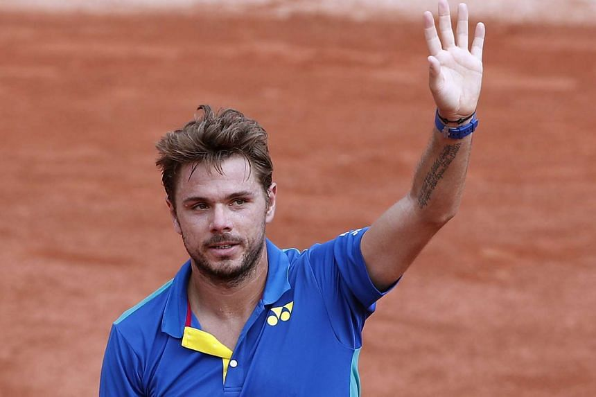 Wawrinka reacts after winning against Alexandr Dolgopolov of Ukraine.