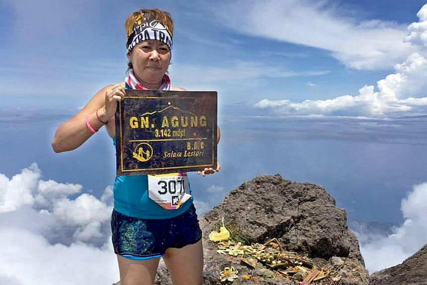 Ms Amy Wong Kum Ling at the summit of Mount Agung in Bali, Indonesia. The fan of extreme sports died of altitude sickness on her way to Mount Everest's base camp last Friday.