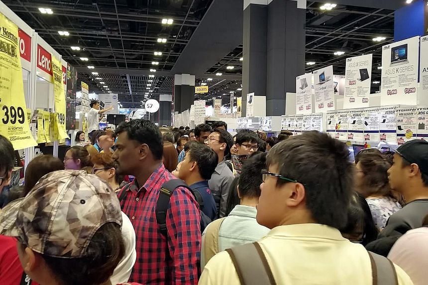 The crowd at this year's IT Show in Suntec Singapore. Visitors can look forward to new launches and bargains at such tech shows.