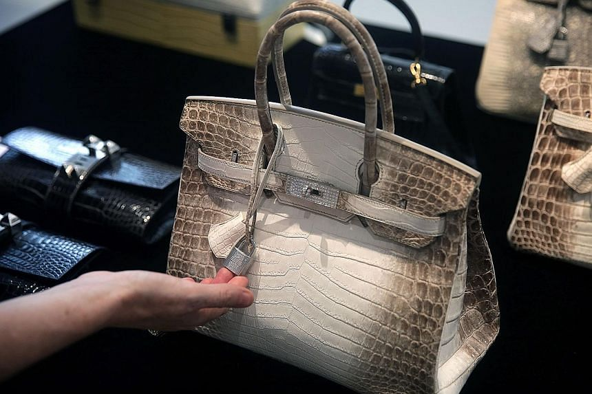 A Himalaya Niloticus Crocodile Diamond Birkin 30 on display at a preview at Christie's in Hong Kong last year. It is identical to the Hermes handbag that broke the record for the world's most expensive handbag sold at an auction yesterday. Only one o