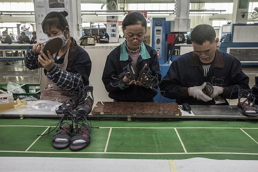 Workers at the Huajian shoe factory, a supplier for Ms Ivanka Trump's line of shoes, in Dongguan, as seen last December. Activist Hua Haifeng has been held by police and accused of illegally using eavesdropping equipment.