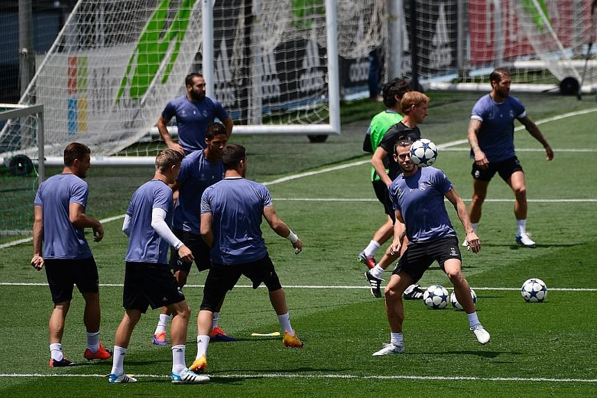 Real Madrid's Gareth Bale prepares to head the ball during a training session in Madrid on Tuesday. The Welshman has missed Real's last eight games but is aiming for a third Champions League triumph in the game against Juventus on Saturday in his hom
