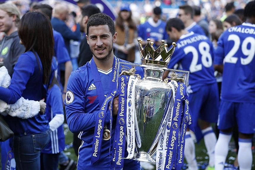 Chelsea's Eden Hazard with the English Premier League trophy at Stamford Bridge on May 21. He said that despite the club returning to the Champions League next season, it is the Blues' intention to keep the EPL title in their possession.