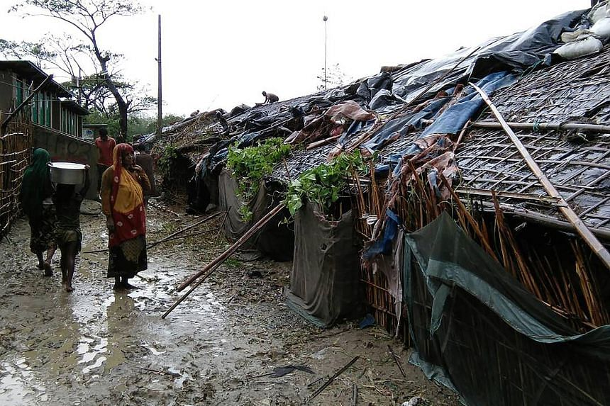 Rohingya refugees at a camp in Cox's Bazar on Tuesday after Cyclone Mora struck. At least 16,010 homes in such camps were destroyed or damaged.