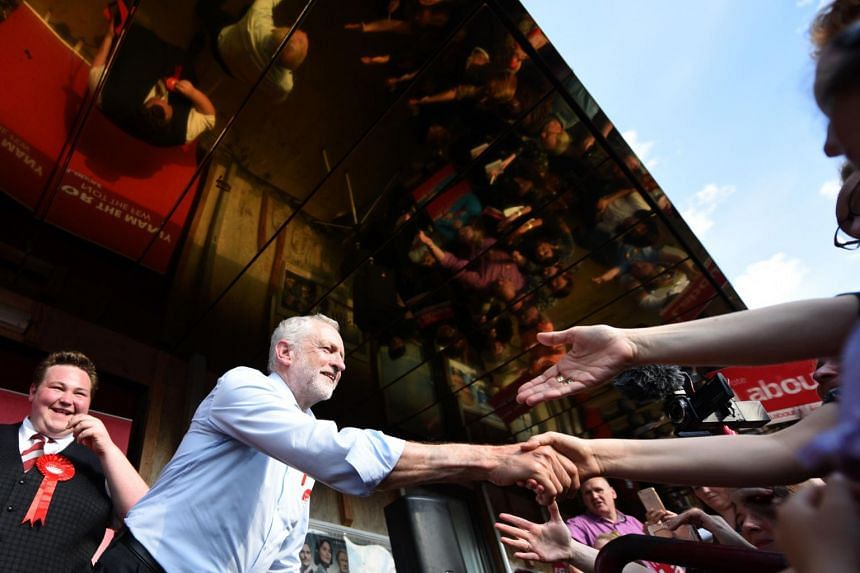 Britain's main opposition Labour Party leader Jeremy Corbyn shakes hands with supporters during a general election campaign event in Goole, northern England on May 22, 2017.