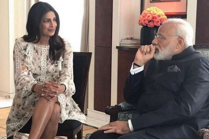 Priyanka Chopra posted a photo on Facebook where she wore a knee-length dress during a meeting with Indian Prime Minister Narendra Modi.