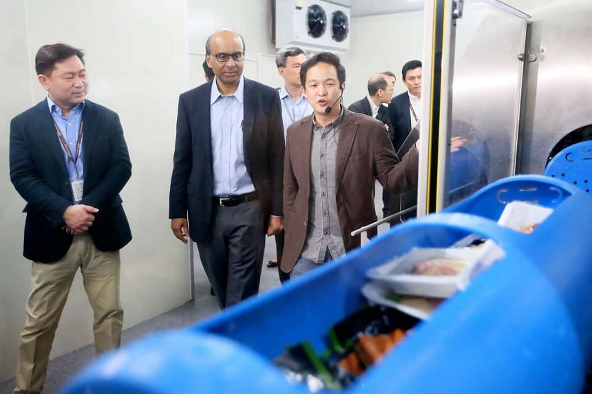Mr Andrew Kwan (left), group managing director of Commonwealth Capital, and Deputy Prime Minister Tharman Shanmugaratnam being shown how a high-pressure processing line works.
