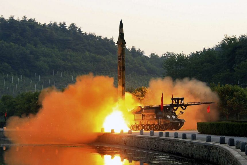 The test-fire of a ballistic rocket equipped with precision guidance system, at an undisclosed location in North Korea.