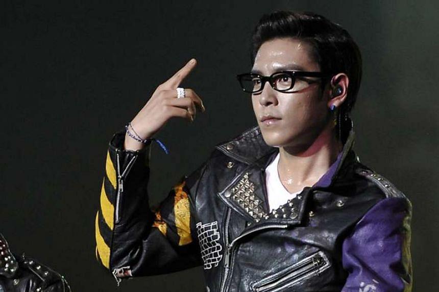Top of K-pop group Big Bang performing at the Korean Music Wave 2011 held at the Singapore Indoor Stadium. ST PHOTO: MUGILAN RAJASEGERAN