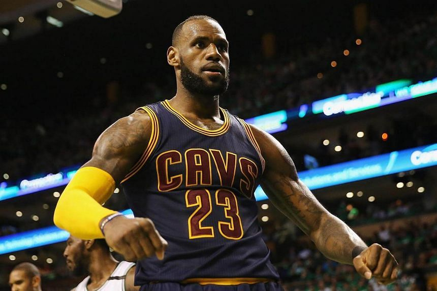 LeBron James #23 of the Cleveland Cavaliers celebrates his dunk in the third quarter against the Boston Celtics.