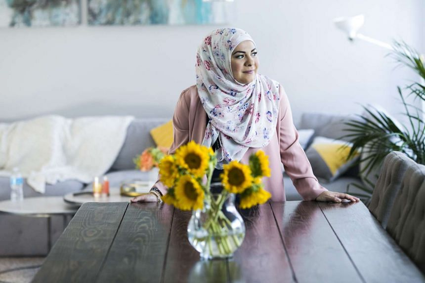 Ms Amanda Saab bakes her grandmother's syrup-soaked namoura cake in preparation for Ramadan. PHOTO: NYTIMES