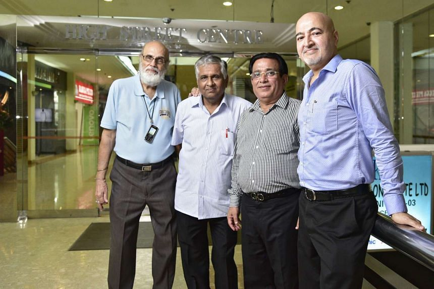 From left: Mr Chatru Vaswani, Mr Raj Thakurdas, Mr Ramesh Jethwani and Mr Deepak Gurnani in Hill Street Centre. The men, who are volunteers in the community's activities, are among the older Sindhis who gather in the High Street area to speak Sindh