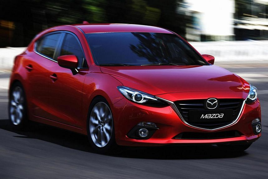 Due to the exemption for petrol models with port fuel injection, a car like the Toyota Corolla Altis, which employs port fuel injection, could enjoy a tax rebate, while a similar model, such as the Mazda 3 (above), would be slapped with a surcharge,