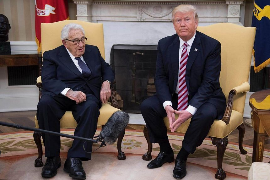 US President Donald Trump (right) speaks with former US Secretary of State Henry Kissinger during a meeting in the Oval Office of the White House.