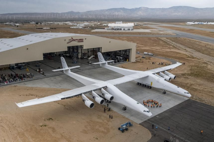 The Stratolaunch plane is pushed out of the hanger for the first time in the Mojave desert, California on May 31, 2017.