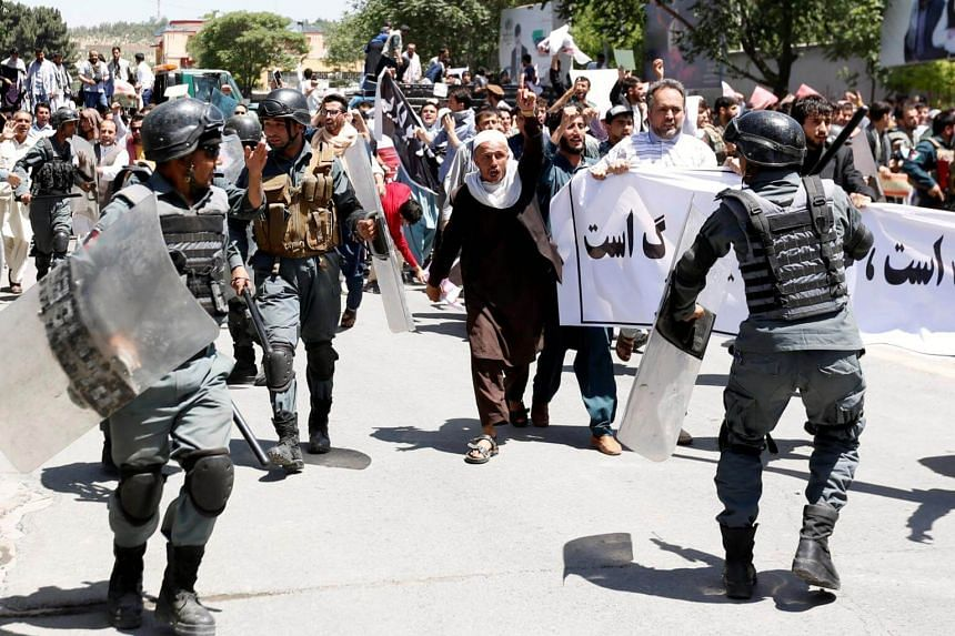 Afghan riot police clash with demonstrators during a protest in Kabul, Afghanistan, on June 2, 2017.