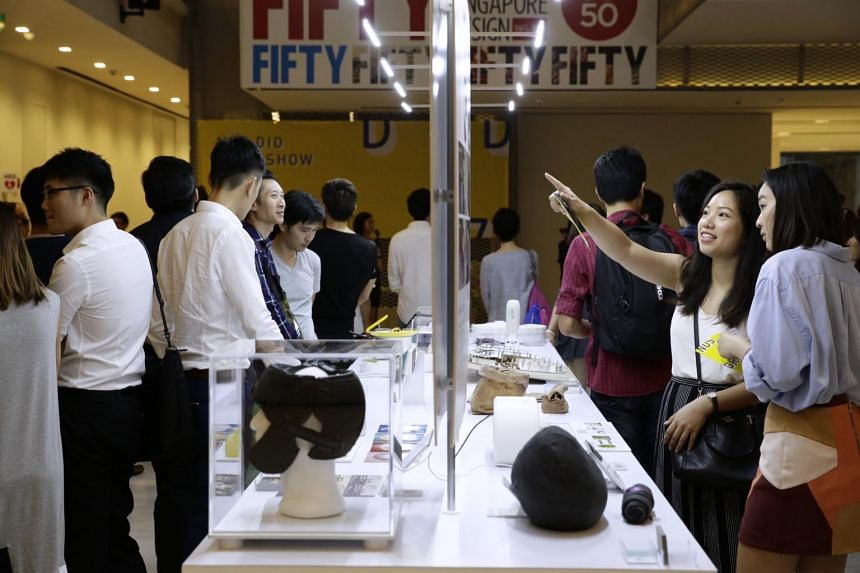 Invited guests looking at a showcase of design works by students from the National University of Singapore (NUS) School of Design and Environment, at a graduation show at the National Design Centre on June 2, 2017.