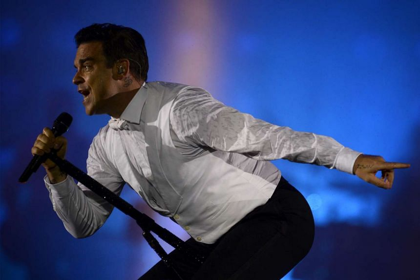 British pop star Robbie Williams (above in a file photo) is joining the star-studded line-up.