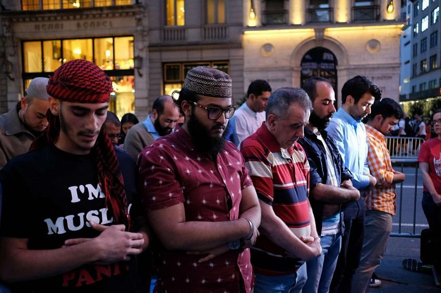 Muslims pray on the Fifth Avenue after Iftar, breaking fast during their holy month of Ramadan.