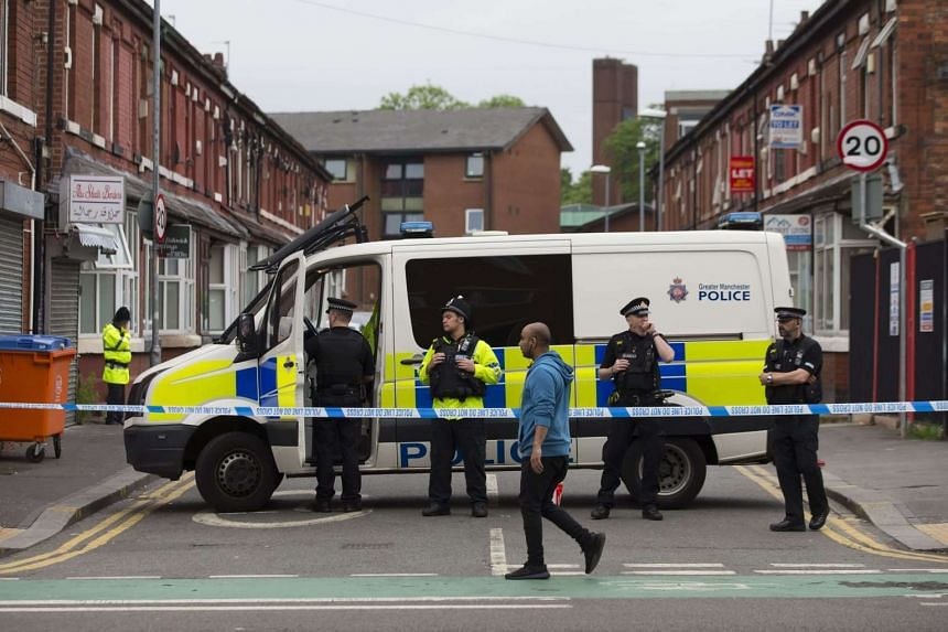 Police officers stand guard on Banff Road in the Rusholme area of Manchester, in north west England on May 29, 2017.