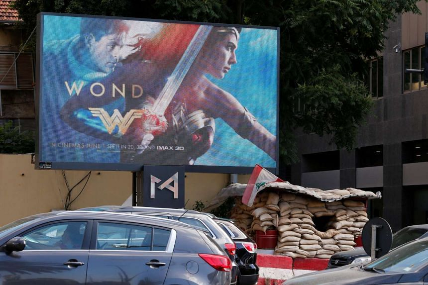 An advertisement for the Wonder Woman movie is pictured near an army post in Beirut, Lebanon.