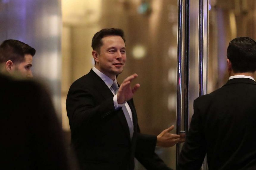 Musk (above, in a file photo) had vowed to quit if Trump scrapped the climate agreements.
