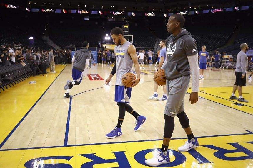 Stephen Curry (left) and Andre Iguodala of the Golden State Warriors practice for the 2017 NBA Finals at ORACLE Arena on May 31, 2017.