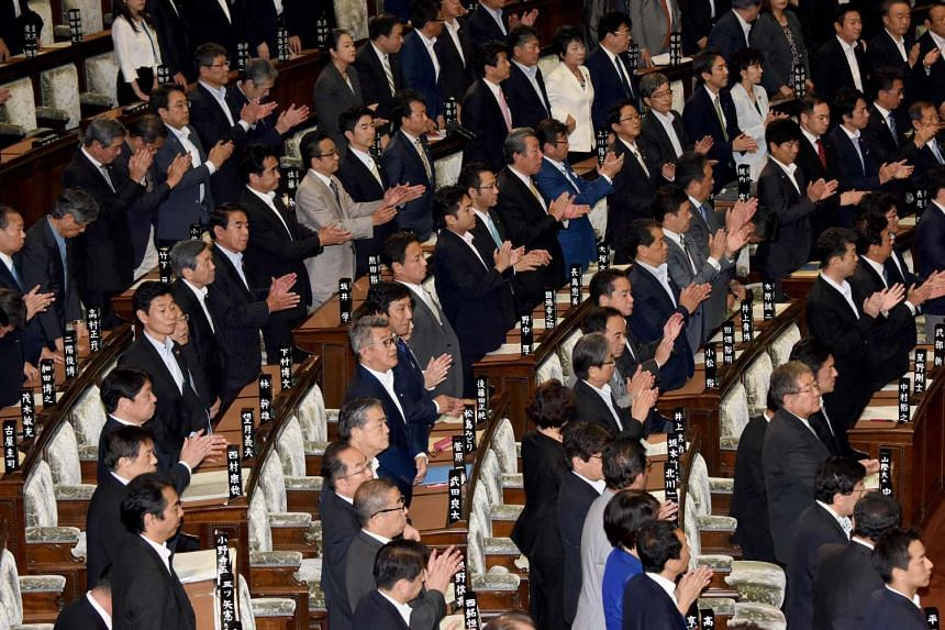 Members of Japan's Lower House of Parliament stand up during the plenary session in Tokyo on Friday (June 2) to support a Bill allowing ageing Emperor Akihito to step down.