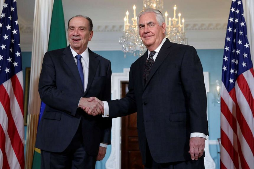 Tillerson (right) shakes hands with Brazilian Foreign Minister Aloysio Nunes Ferreira before their meeting.