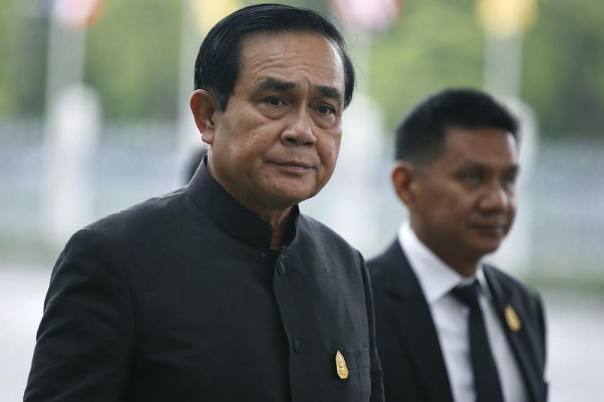 Thai Prime Minister Prayut Chan-o-cha (left) walks to a weekly cabinet meeting at the Government House in Bangkok, Thailand, on May 30, 2017.